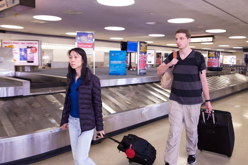 Danielle Wang and her husband, Jeff, arrive at Newark International Airport on Aug. 9. (Dai Bing/Epoch Times)