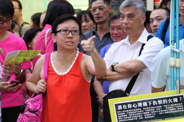 "A July 14, 2013 photo of Lam Wai Sze, a Hong Kong female teacher who spoke in defense of Falun Gong. She recently received a death threat in a letter written by someone who identified themselves as an ""underground Communist Party member."" (Pan Zai Shu/Epoch Times)"