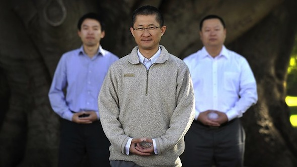 Dr Albert Lin (foreground) with Frank and Sam who fled China Picture: Theo Fakos Source: The Sunday Times