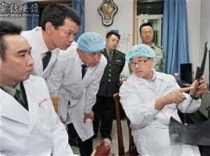 Wang Lijun, former police chief of the city of Jinzhou, speaks to policemen and doctors at a secret research center that he lead.  Courtesy of WOIPFG