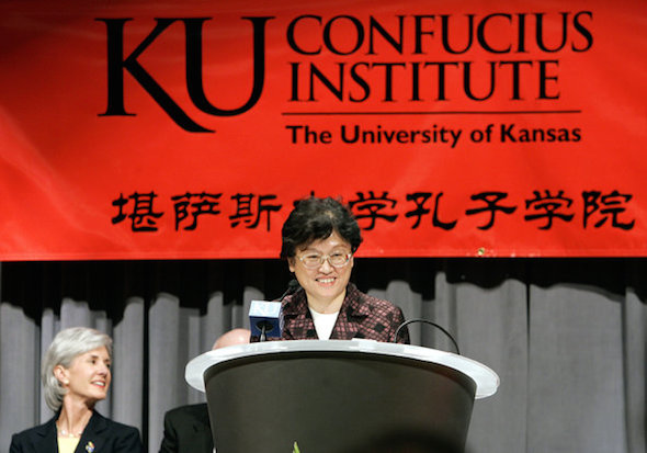 Wu Qidi, Chinese deputy minister of education, spoke at the opening of the Confucius Institute at the University of Kansas' Edwards campus in 2006 with Kathleen Sebelius, then governor of Kansas, in the background. (John Sleezer/Associated Press, via The Kansas City Star)