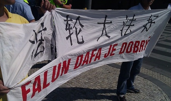 A banner that was ripped when thugs tried to snatch it from practitioners.