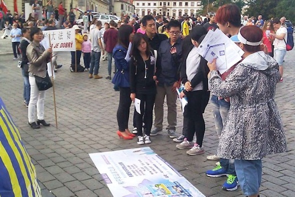 Chinese people stop by to learn facts about the persecution in China.