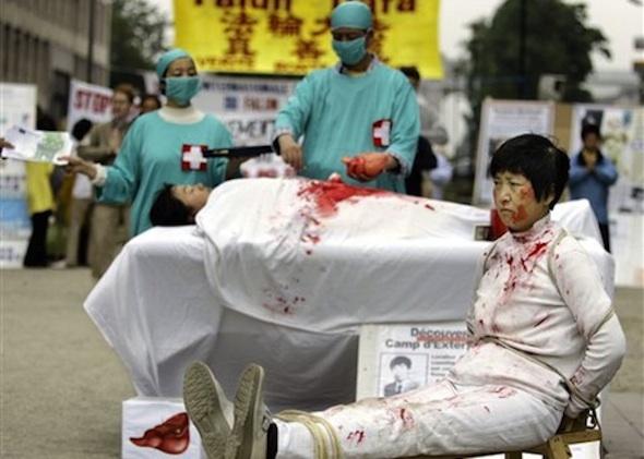 Falun Gong members demonstrate outside EU leaders meeting in 2006 against China's illegal human organ harvesting / AP