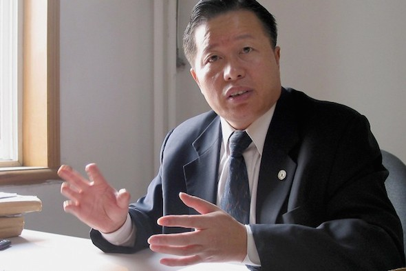 Persecuted human rights lawyer Gao Zhisheng is seen in his former office in Beijing in a November 2, 2005, file photo. A group of U.S. Senators are requesting Gao's transfer to the United States for medical attention. (Verna Yu/AFP/Getty Images)