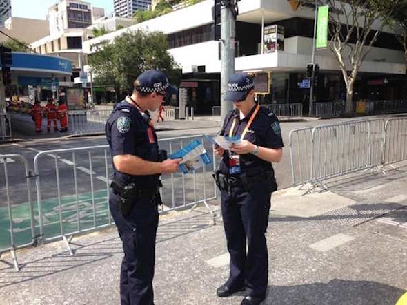 Police officers reading about Falun Dafa