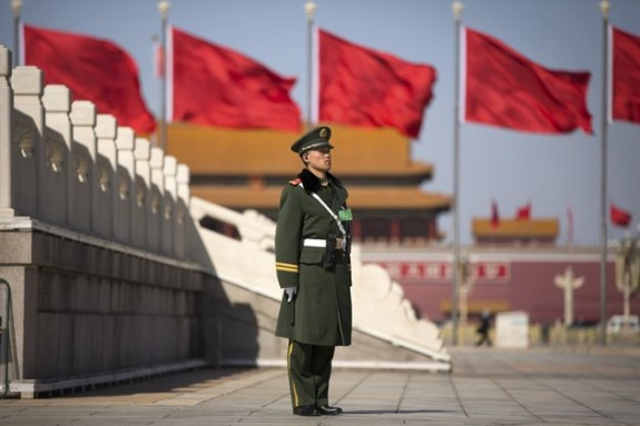A Chinese paramilitary policeman stands on duty on Tiananmen Square before delegates arrive for the opening session of the Chinese People's Political Consultative Conference in Beijing's Great Hall of the People, Tuesday, March 3, 2015. The more than 2,000 members of China's top legislative advisory body convened their annual meeting Tuesday, kicking off a political high season. Photo: Mark Schiefelbein, Associated Press - Ap