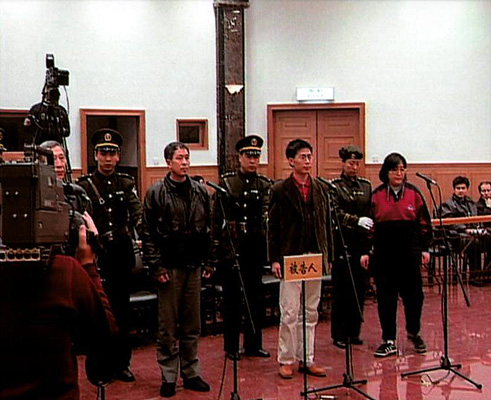 Wang Zhiwen (3rd L) stands trial with three other Falun Dafa practitioners on Dec. 26, 1999. This show trial was meant to influence other practitioners, helping convince them to give up the spiritual discipline. (via Wang family)
