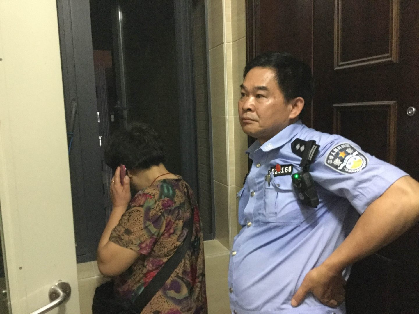 A policeman tasked with stalking Wang Zhiwen. (Courtesy of Danielle Wang)