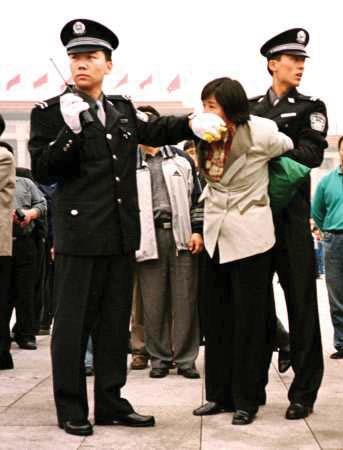 Falun Gong practitioner arrested in Tiananmen Square, Beijing, China.